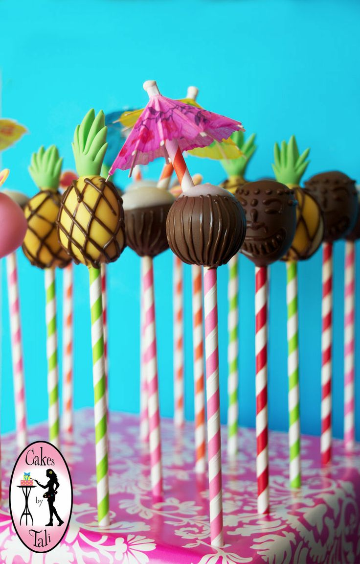 Hawaiian theme cake pops: Pina Colada, Pineaplle, Tiki head, flower. www.facebook.com/talipopsart http://www.talipops.com Ventura, CA