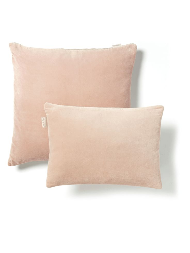 Add tactile materials in the form of  a gorgeous velvet blush cushion from Cox & Cox