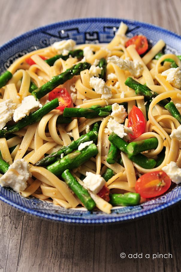 A quick, easy recipe for Spring Asparagus and Tomato Pasta with Feta. Perfect for lunches or weeknight suppers from @addapinch | Robyn Stone | Robyn Stone
