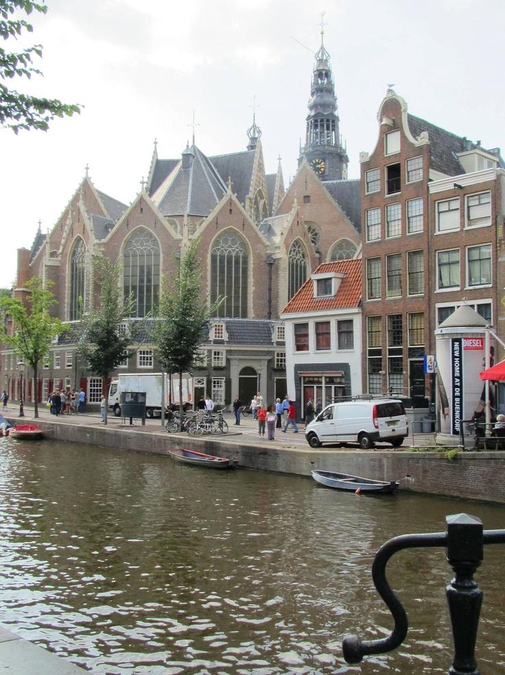 De Oude Kerk (The Old Church) one of the oldest buildings in Amsterdam (13th century), seen from the Oudezijds Voorburgwal - Oude Kerksplein, Amsterdam
