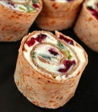 Christmas Pinwheel Hors d'oevres - Cranberry, Feta, Cream Cheese, Green Onion + pepper jelly!