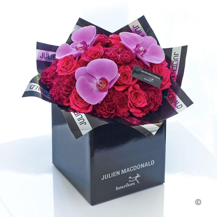 This design is an irresistibly chic combination of exquisite cool pink orchids and velvety roses. Look closer and see how each perfect orchid flower has a refined elegance that is truly exceptional. Set against canopy of ruby and cerise roses, this is an ultra-stylish gift for someone very special.