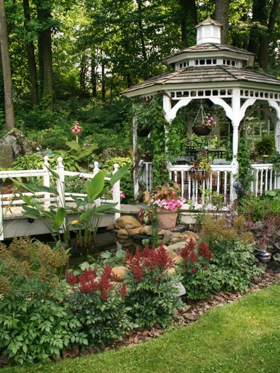 the bridge and gazebo are beautiful together in this garden would love a gazebo