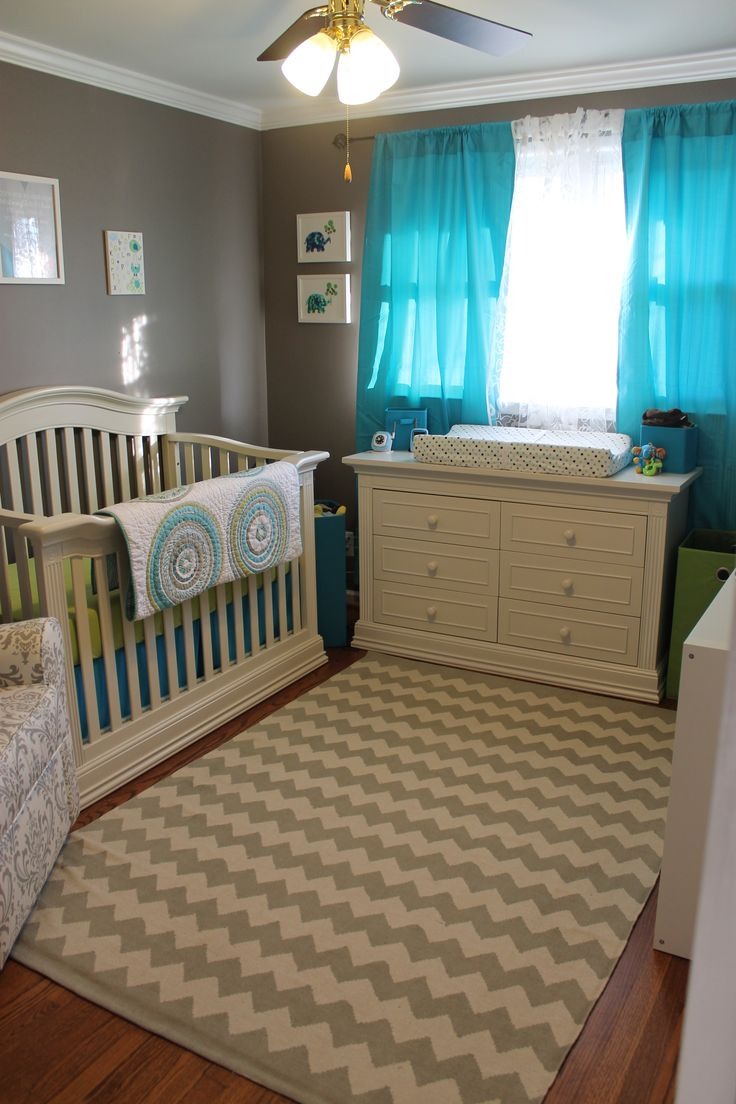 This is definitely what I am going for with a nursery. Gray with accents of blue or yellow!