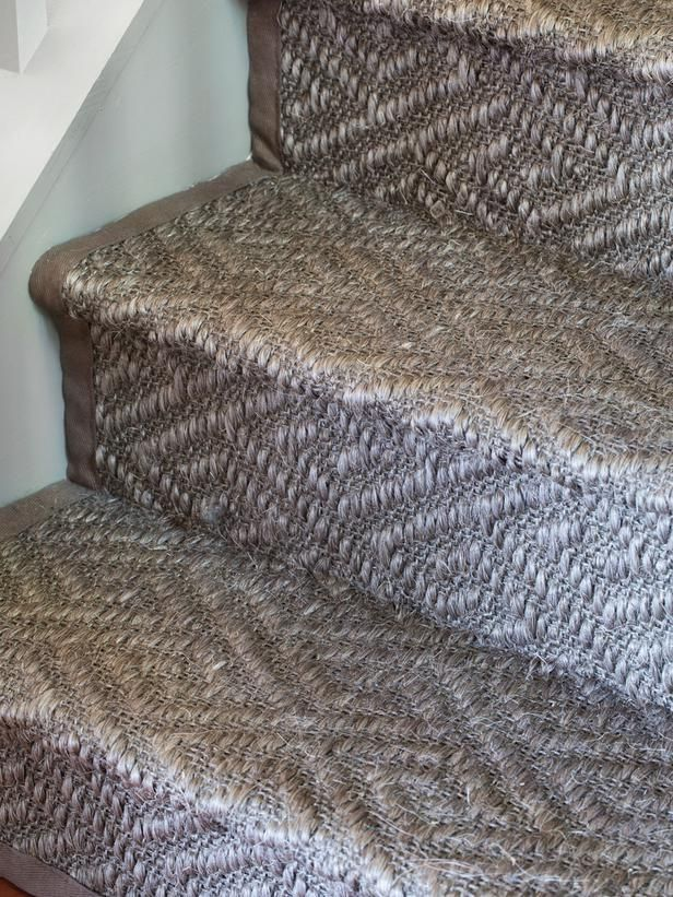 There are two different methods for covering stairs: stairwell runners and wall-to-wall carpeting. Runners offer a chance to showcase a small portion of the stained stairs themselves; however, if a staircase is made of contractor-grade pine treads, they're unlikely to take stain well. In that case it's best to consider wall-to-wall carpeting instead placing the focus on the carpet material. For a tailored effect, have the edges of the carpet bound with a contrasting or coordinating canvas.