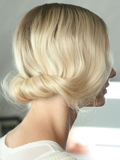 We love this soft hair roll for Spring. Hair is rolled above the neck for a chic yet simple do.