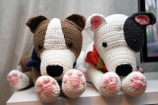This is a crochet pattern for a Staffordshire Bull Terrier (also known as English Stafford), American Staffordshire Terrier or Pitbull Terrier. I have tried to catch all specific characteristics in this cute cuddle. He/she can sit the way only a Stafford/Pitbull can (even with the back paws up in the air), lie down and give his paw to you. And ofcourse it can look very waggish :-) The dog in the pattern is white with grey spots but can be crocheted with every colour you want to make...