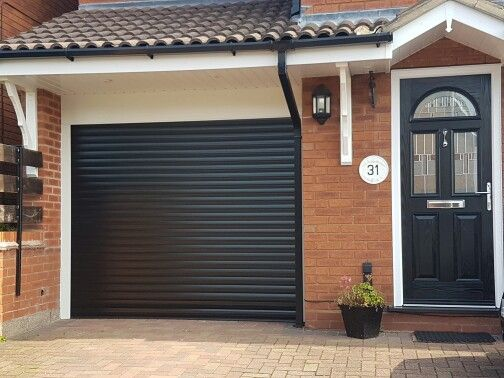 Garage door finished in black roller shutter door insulated remote control actuation with safety bottom rail : roller doors garage - pezcame.com