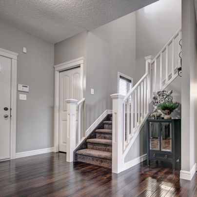 The front entry of the Winchester - love the rich hardwood flooring and decorative nook!