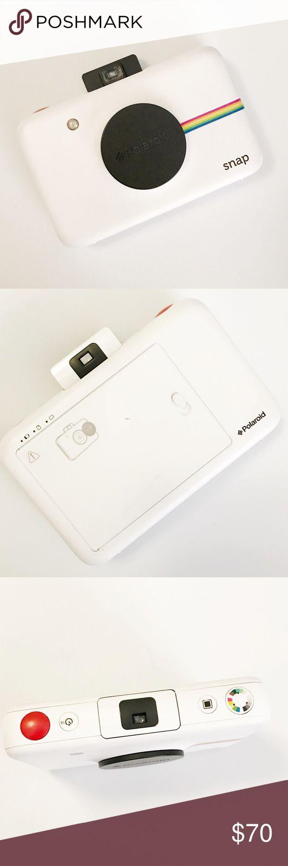 Polaroid Snap Camera in White Fully functional polaroid Snap Camera in White, used once or twice. Polaroid Other