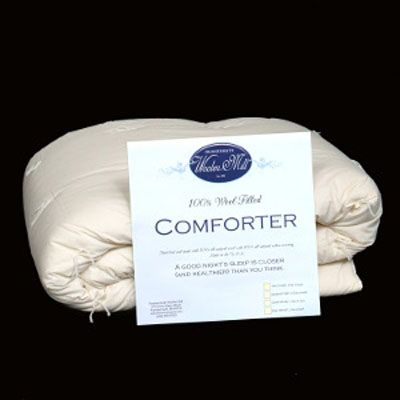 Hand-tied wool-filled muslin comforter. Comforters are made with fluffy, wool batts, covered in natural unbleached muslin, and hand-stitched in a long basting stitch.  Now On Sale @ http://a2zsell.com