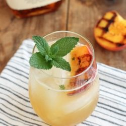 Grilled peaches get muddled with mint, sugar, and lime juice and topped with bourbon.