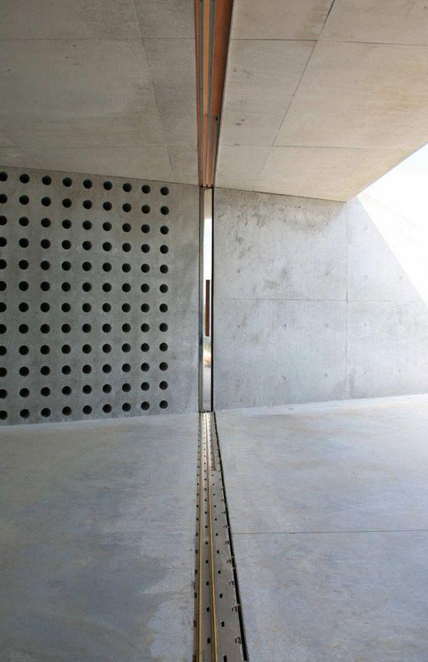 Wine Cellar sunk into a concrete wall. Genius for temperature control!