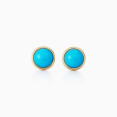 Elsa Peretti® Color by the Yard earrings in 18k gold with turquoise cabochons.