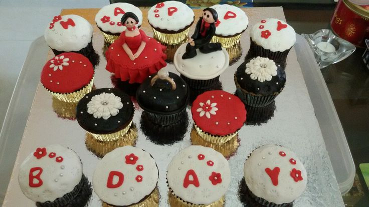 Themed chocolate n vanilla cupcakes....The groom is wishing his bride on her birthday....which also happens to be their engagement day !!!!!!