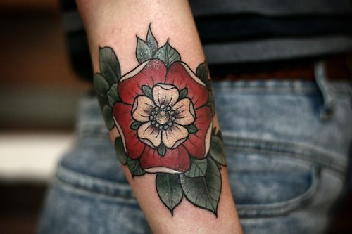 Tudor rose. i live in Tudor country maybe smaller without the greenery?