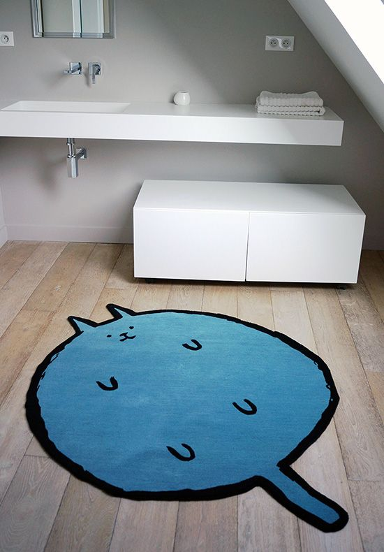 """French graphic designer Jean Jullien teamed up with Les Manufactures d'Inopia to createthis awesome handwoven rug, called Lili. Made from hand knotted wool, measures about 47"""" in diameter."""