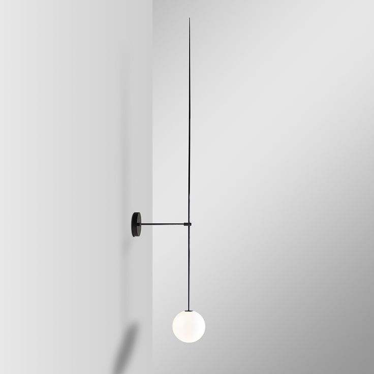 Michael Anastassiades' Mobile Chandelier 6 is a series of light-weight floating and balancing geometries. Each chandelier piece is comprised of black patinated brass, with mouth-blown opaline spheres for illumination and varying pendant rod lengths to order. The resulting forms are effortless and seem to engage in space with a unique lightness.