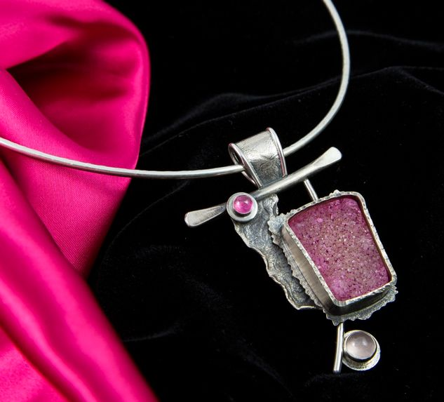 Free and Clear by Blair Anderson Sterling Silver, Pink Tourmaline, Druzy, Rose Quartz. Starting with the Tourmaline, the journey from diagnosis, disease, to cure is depicted in this piece about victory.