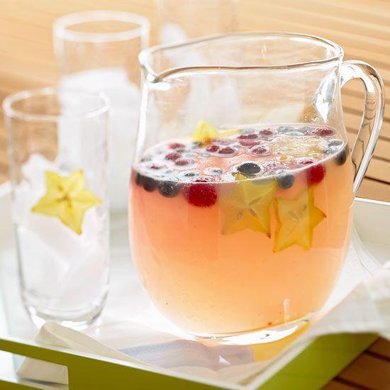 Coconut lemonade gets patriotic with floating blueberries, raspberries, and star fruit.