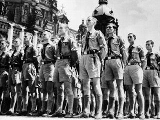 This picture shows a group of older Hitler Youth Boys at a Nazi Rally. The boys are the perfect examples of health, youth, and athleticism, which is owed to regimented exercise and drills provided by military leaders. The purpose of the drills and exercise was to shape the next generation of German soldiers into super soldiers with Nazi ideals engrained into their blood. This theme of militant regimentation is shown throughout our board and is part of the foundation of the Hitler Youth.