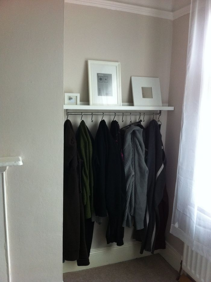 When hooks are attached underneath this rail it becomes a multipurpose piece of furniture in your bedroom or entryway: You can organize your jackets on the bottom and showcase artwork on top. See more at IKEA Hackers »   - HouseBeautiful.com