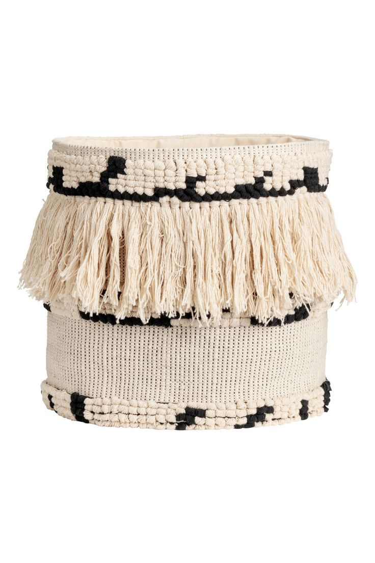 Natural white/black. Soft, round storage basket in jacquard-weave cotton fabric with fringe. Diameter 13 in., height 14 1/2 in.
