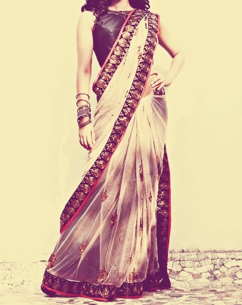 Cream, red and black sari with a pretty boat neck blouse. By Sapna Amin.