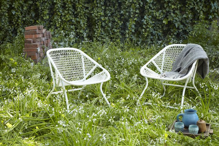 Fermob Sixties Armchair. Photo by: Caitlin Atkinson for Flora Grubb Gardens