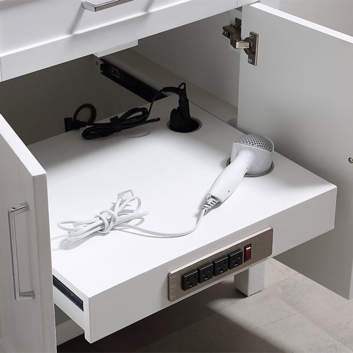 """The Tahoe is every master bath's dream vanity. Technology, functionality and convenience are what really make this piece impressive. From drawers featuring built-in organizers, to a fully integrated power station, we made sure to think of every little detail. The Tahoe is appropriately complimented by modern chrome pulls & soft-close hinges and drawer glides. In addition two large 20"""" under mount ceramic sink topped with lavish Carrera white marble for a truly astonishing overall effect a..."""