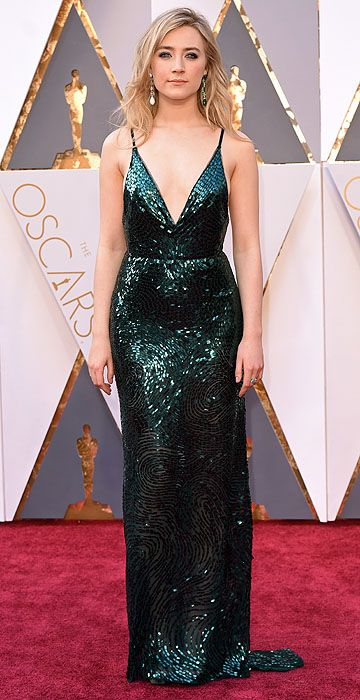 Academy Awards 2016: Arrivals. Saoirse Ronan in a custom Calvin Klein Collection sequin gown with coordinating Chopard emerald jewels