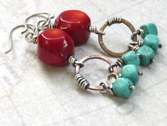 Southwestern style earrings with chunks of red coral wire wrapped to copper rings.