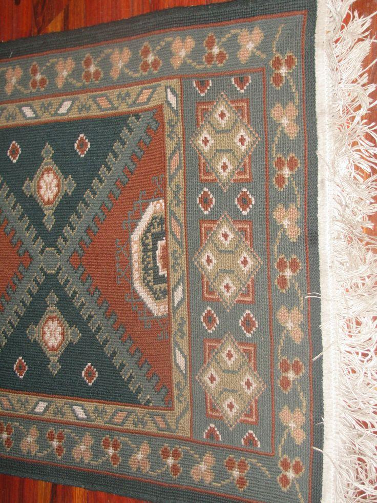 Detalle alfombra punto de cruz