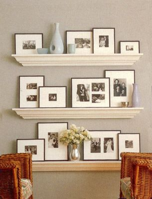 Beautiful way to display photos. Shelves, not just frames nailed into the