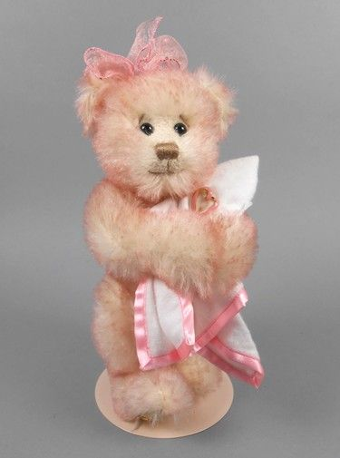 """Adopt a Bear todayThe Heart of Hope by: The Franklin Mint 10"""" fully jointed mohair, poly/pellet stuffed. Magnetic paws, pink and white blanket with pink ribbon heart pin. Comes with stand. Original tush tag and foot button."""