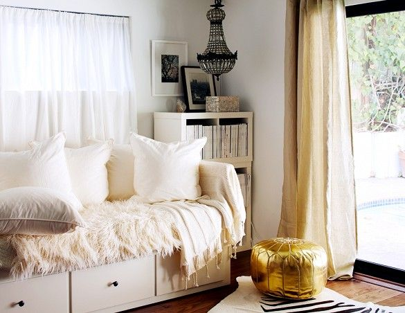 Neutral bedroom with daybed and crystal chandelier