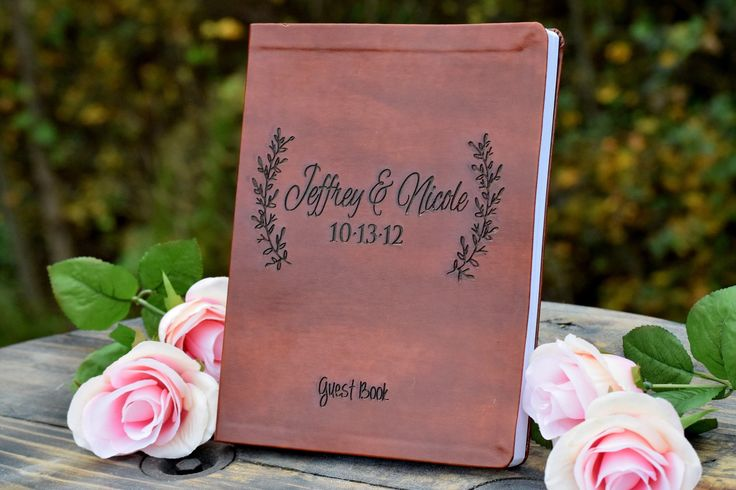 "Leather Engraved Leaf Guest Book - Wedding Guest Book - Leather Journal - Personalized Journal - Personalized Gift - Guest Book Alternative - Personalized Leather Journal. This beautiful leather custom wedding guest book can be customized with your names and wedding date. There are additional font options available. This leather book is approx. 8"" wide x 1"" thick x 10"" tall (vertical position). It includes 256 lines 2 sided pages for journal entries and/or notes from your wedding guests...."