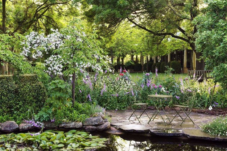 A quaint outdoor sitting area surrounded by foxgloves and poppies, waterlilies and white-blossomed crabapple in a country garden on the outskirts of the Barossa Valley. Photography: Brigid Arnott | Story: Australian House & Garden