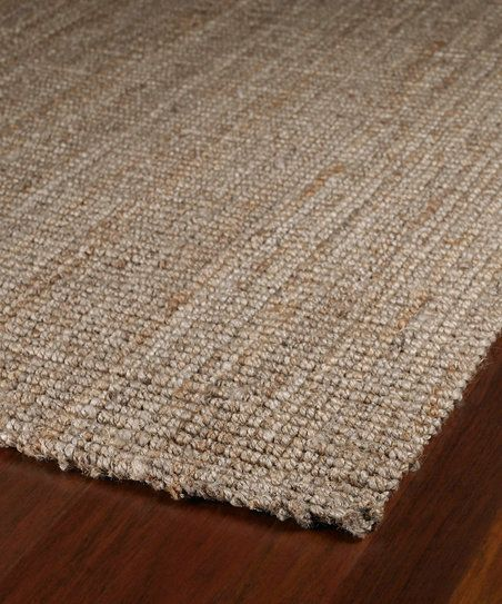 A rug that bare feet can truly appreciate, this all-natural jute rug elevates the bare essentials to the essence of fashion.