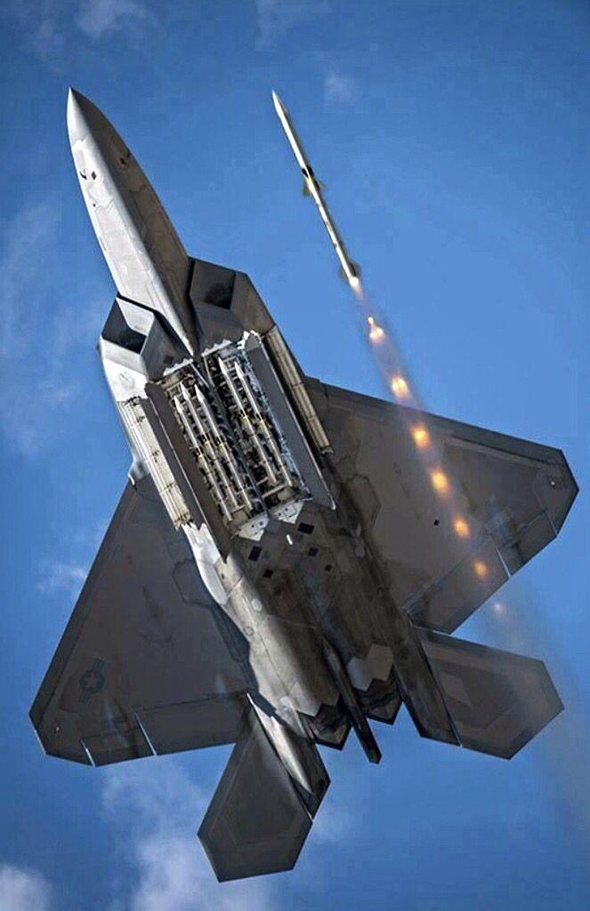 A USAF Lockheed-Martin F-22A Raptor firing a missile.