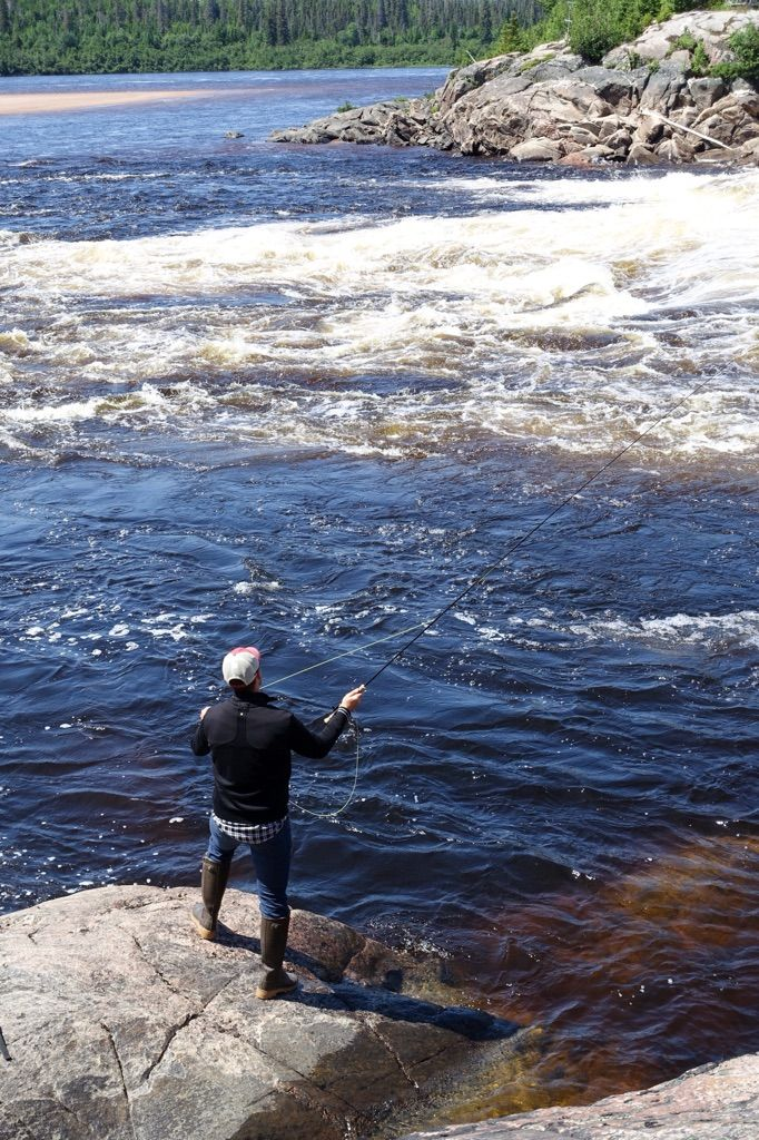 Fly Fishing in Waterfall in Quebec, Côte Nord