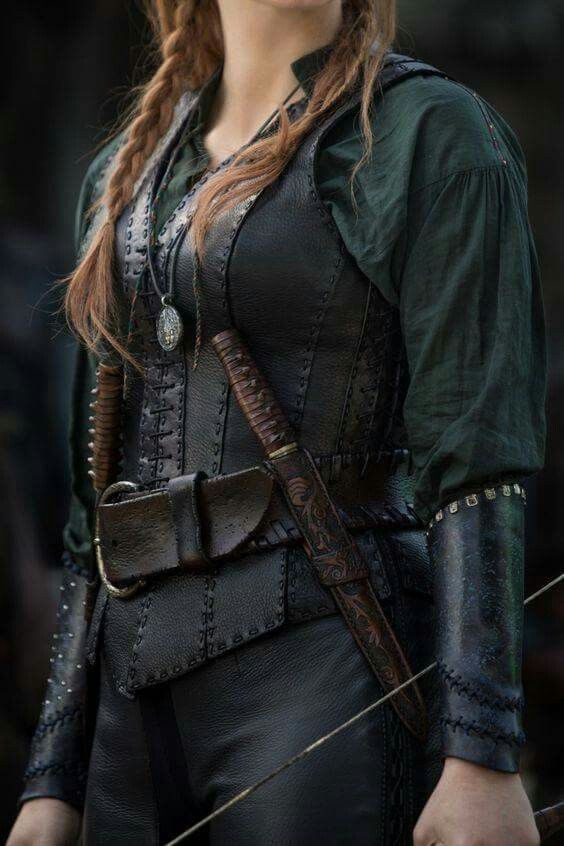 She had a black leather jerkin over a dark, sage green shirt. The flowing sleeves were bound at her forearms by black braces, and on her belt hung twin daggers. ---// her comfort