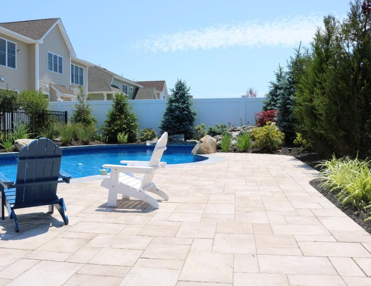 This beautiful new york pool patio was created by design for Pool design long island