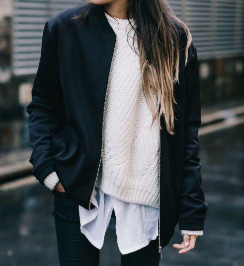 white shirt, white sweater, black navy blue bomber jacket, black pants