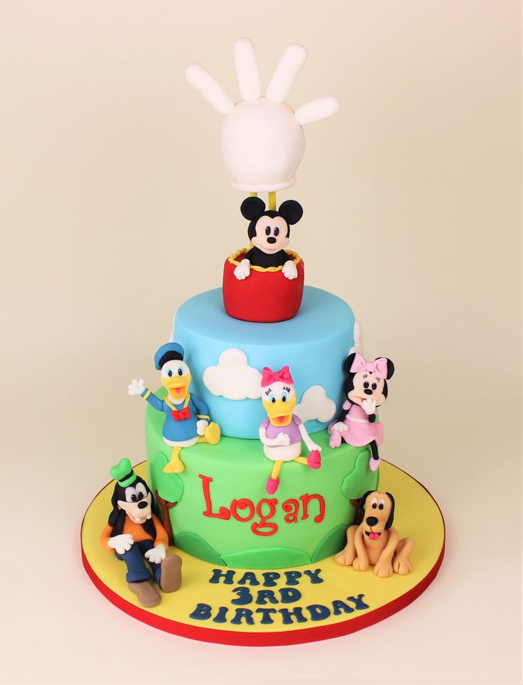 Disney cake with Mickey Mouse, Minnie Mouse, Daisy Duck, Donald Duck, Goofy and Pluto