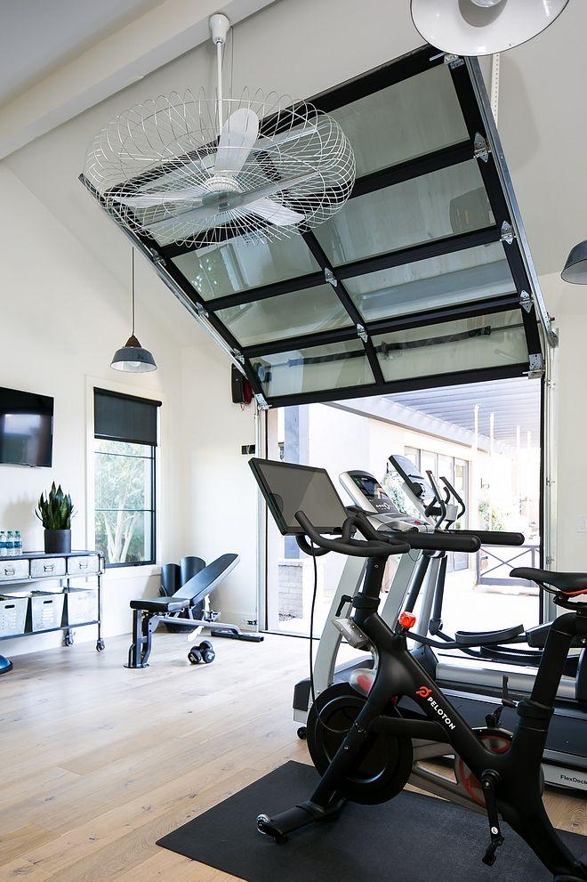 Home gym with glass and steel garage door attics bonus rooms