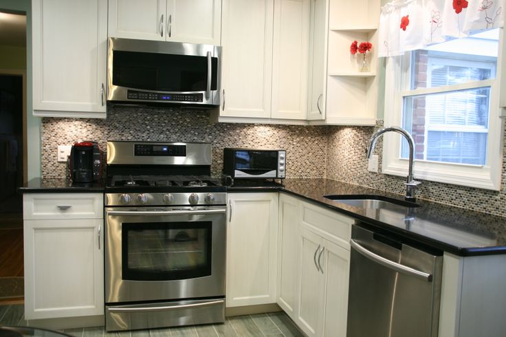 Painted White Modified Shaker Kitchen Cabinets With A