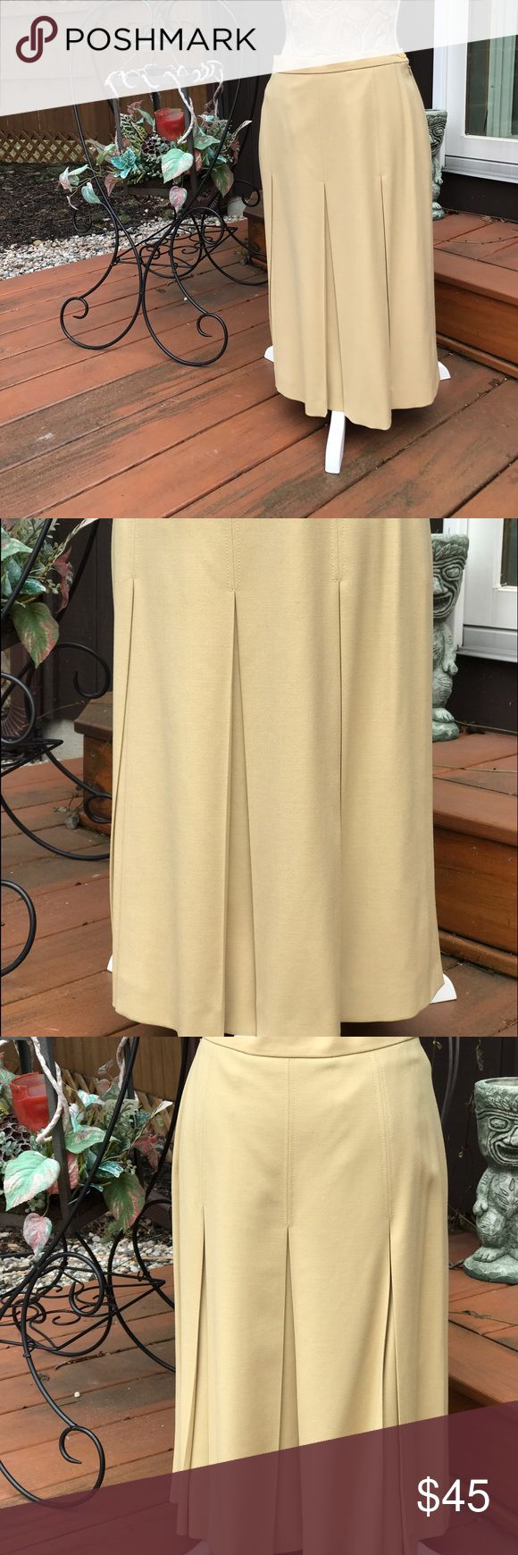VTG LOUIS FERAUD PLEATED SKIRT LONG SIZE 8 VINTAGE LOUIS FERAUD LONG PLEATED LINED SKIRT SIZE 8.  THE SKIRT IS THE COLOR LIGHT BROWN/BEIGE AND A LITTLE HEAVIER. GOOD CONDITION AND DOES HAVE VERY FEW SMALL STAINS IN 1 AREA (PICTURES).  THIS IS MADE OF 98% WOOL 2% SPANDEX.  THE LINING IS 100% RAYON. LOUIS FERAUD Skirts