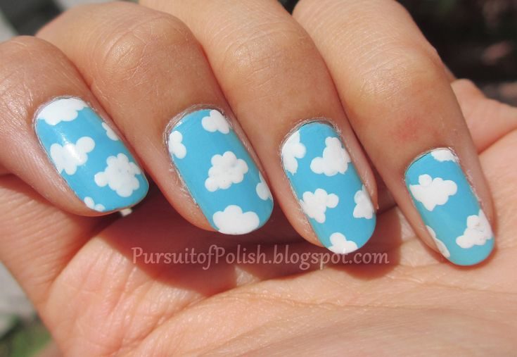 Nail art. Clouds on blue sky