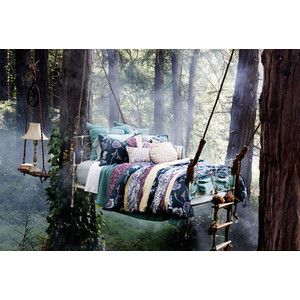 What would it be like to sleep in a suspended bed in a beautiful forest?